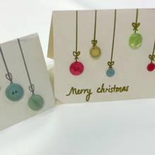 Jak ozdobić świąteczną kartkę za pomocą guzików?