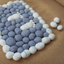 Jak zrobić ozdobny dywanik z wełny?
