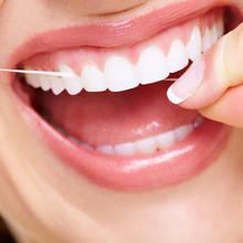 Jak dobrze czyścić zęby nitką?